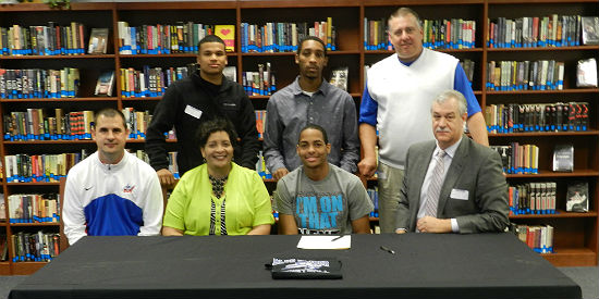 Sitting (Left to Right): Jason Holland, Anna Wallace, Bryan Wallace, Lindsey Wilson Head Coach Paul Peck. Standing: R.J. Tayl